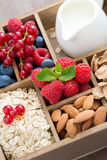 Box with breakfast items - oatmeal, granola, nuts, berries Stock Image