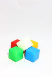 Box of bricks. Five colorful dice lie on a white background Royalty Free Stock Image