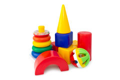 Box of bricks with the pyramid and the rattle. Colorful box of bricks with the pyramid and the rattle. Developing children's toys Royalty Free Stock Photo