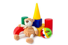 Box of bricks with a teddy bear and rattle. Colorful box of bricks with a teddy bear and a rattle. Developing children's toys Royalty Free Stock Photos