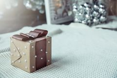 Box with a brown bow and beads, there is a place for an inscription stock images