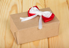 Box from brown paper with red-white bow Stock Image