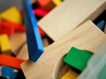Childrens Toys Wooden Building Blocks in Colors. A box of building blocks found in a child`s room. Picture in natural light, blocks have seen use stock photos