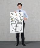 Box with bulbs. Businessman holding placard with box and bulbs Stock Photos