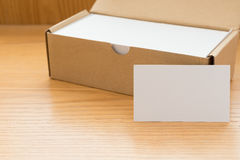 Box of business cards with a blank one good for text and logo Royalty Free Stock Image