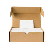 Box of business cards with a blank one good for text & logo stands on top including clipping path Stock Photography