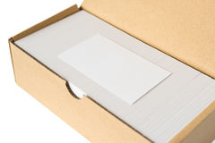 Box of business cards with a blank one good for text & logo stands on top Royalty Free Stock Photos