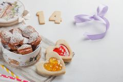 Box with cakes in shape of heart Stock Images