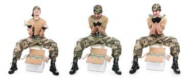 box camouflage guy money 免版税库存图片