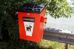 The box for canine waste. In Bulgaria. за кучешки отпадцъци that means for canine waste stock image