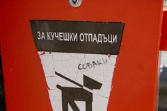 The box for canine waste. In Bulgaria. за кучешки отпадцъци that means for canine waste royalty free stock photo