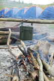 Box canteen pot and tents. Box canteen pot for cooking in camp, with blue tents in the forest, on the mountain, Thailand stock photo