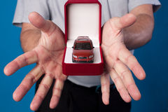 Box with car in mans hands Stock Image