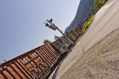 Box cars passing controlled road crossing Royalty Free Stock Photo