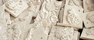 Box of ceramic tiles ready to be glazed. WREXHAM, UNITED KINGDOM - MARCH 14, 2016: Box of ceramic 'mini beasts' tiles ready to be glazed. Part of a workshop Royalty Free Stock Photos