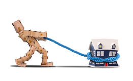 Box character pulling a house with a rope Royalty Free Stock Images