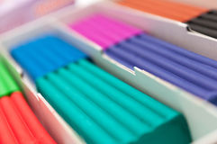 Box with children's colorful plasticine. Blurred Background Stock Images