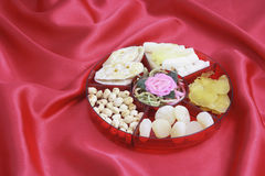 Box of Chinese New Year Delicacies. On Red Velvet Background royalty free stock image