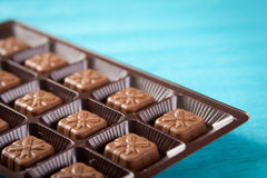Box of chocolate. Box of assorted square chocolate pralines Stock Images