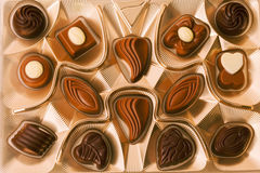 Box of chocolate allsorts. Box of milk chocolate allsorts Royalty Free Stock Images