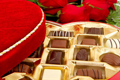 Box of chocolate candy with red roses Royalty Free Stock Photos