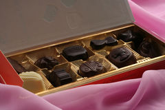 Box of chocolate confectionery. In pink background Royalty Free Stock Images