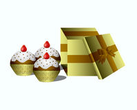 Box of chocolate and a cupcake Royalty Free Stock Images