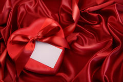 Box of chocolate with red ribbon Stock Photography