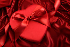 Box of chocolate on red satin Royalty Free Stock Photo