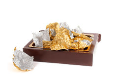 Box and chocolate wrappers Royalty Free Stock Photos