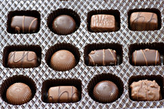Box of chocolates. Dark and milk chocolate, round and squares, all yummy Royalty Free Stock Images