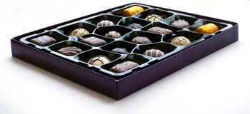Box of chocolates. A box of chocolates isolated on white Royalty Free Stock Image