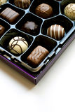 Box of chocolates. A box of chocolates isolated on white Royalty Free Stock Photography