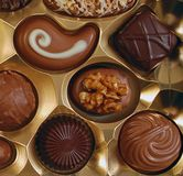 Box of chocolates. Box of assorted chocolates with gold tray Royalty Free Stock Photography