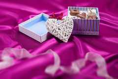 Box with chocolates candies and heart Stock Photos