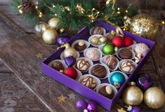 Box of chocolates for christmas. Box of chocolates with colorful baubles for a Merry Christmas stock photo