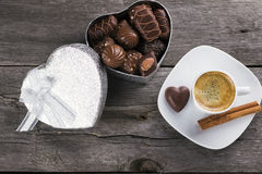 Box of chocolates, cup of coffee on a wooden background. Top vie. W Royalty Free Stock Photos