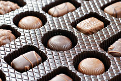 Box of chocolates diagonal. Box of mixed shapes and dark or milk chocolates, at a diagonal Royalty Free Stock Image