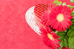 Box of chocolates and flowers for Valentines day. Royalty Free Stock Images