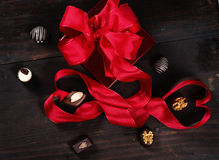 Box of chocolates with red ribbon Royalty Free Stock Image