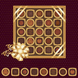 Box of chocolates with a ribbon. A box of chocolates decorated with a gold ribbon as a gift Royalty Free Stock Photography