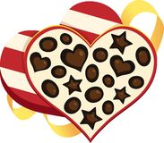 Box of Chocolates. Striped heart gift box with assorted chocolates and ribbon Royalty Free Stock Photos