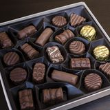 Box of chocolates on table stock image