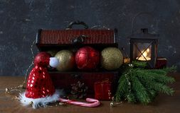 Box with Christmas decor: ball, beads Royalty Free Stock Images