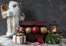 Box with Christmas decor: ball, beads, Santa Claus Stock Photography