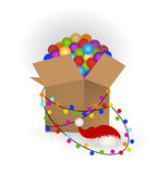 Box of christmas decorations lights and Santa hat. Box of christmas decorations - getting ready to decorate the tree for christmas or storing away decorations stock illustration