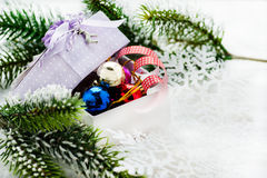 Box of Christmas decorations on snow Royalty Free Stock Photos