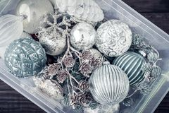 Box with christmas decorations stock images