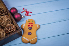 Box with Christmas decorative items on wooden background Royalty Free Stock Photo