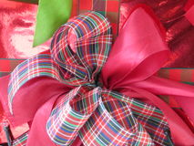Box of Christmas present wrapped with ribbons. Stock Photos